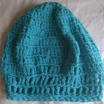 Turquoise hat - crocheted, by Riquee