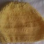 Yellow crocheted hat, by Riquee