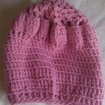 Pink crocheted hat, by Riquee